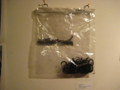 Plastic bags, hair, dead tarantula